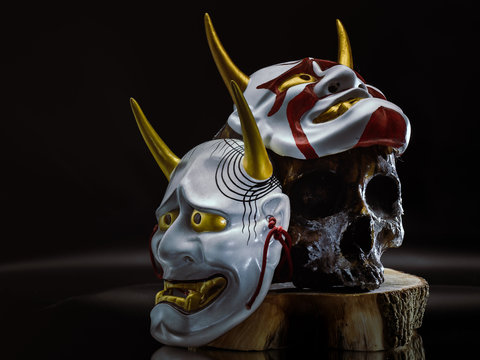 Kabuki Mask, Bushido Warrior Legend. Resin Made Skull with Bushido Iron Helmet and Kabuki Mask closeup on background.