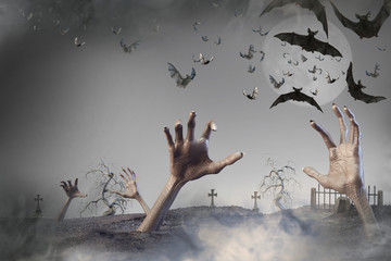 3D Illustration of zombie hand sticking out of the ground Halloween background