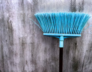 Old Cyan Plastic Broomstick for Cleaning Wet Floor