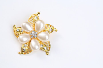 diamond and pearl on golden flower with brooch