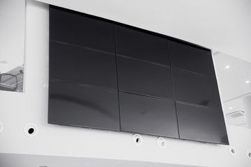 multiple screen LCD panel display in modern building office wall with clipping path at screen