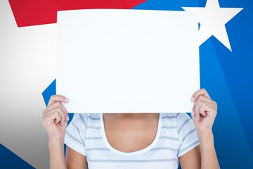 Composite image of woman holding blank sign in front of face