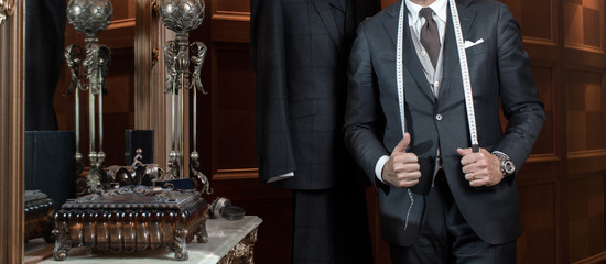 Tailor hands expensive tailoring individual suits