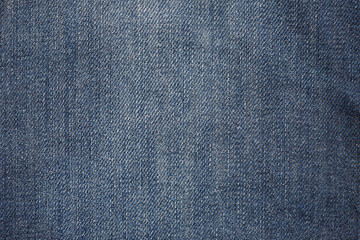 Used old blue jeans fabric closeup shot, abstract texture