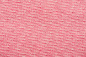 Pink cotton fabric fragment, macro shot abstract texture
