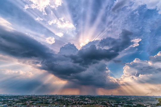 Landscape afternoon in a small town with sun rays through the clouds seen from above as beautiful paintings