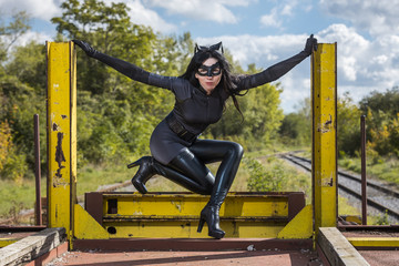 Woman in Catwoman costume on railroad waggon