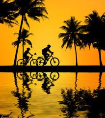 silhouette Sport man whit bike on blurry sunrise background