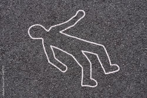 crime scene on street - white shape of body on asphalt