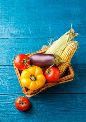 Picture on top of basket with autumn vegetables