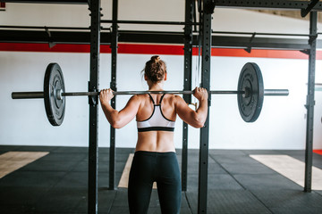 Fitness girl lifting weights