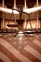 Decorative Scales of Justice in the Courtroom and flag of the United States