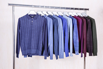 Men's sweaters on hangers in the store