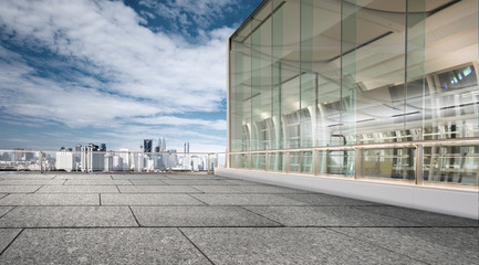 empty marble floor with cityscape of modern city