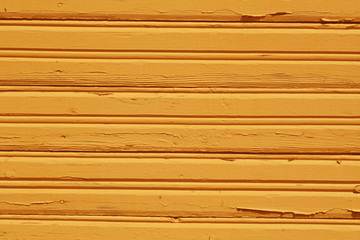 Orange grungy wooden wall pattern.