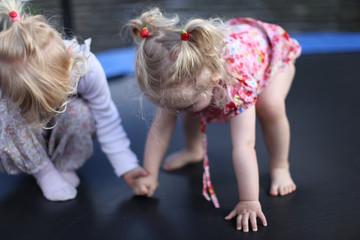 sisters on trampoline, kindergarten, scandinavian child