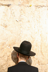 jew praying at the wailing wall in jerusalem israel