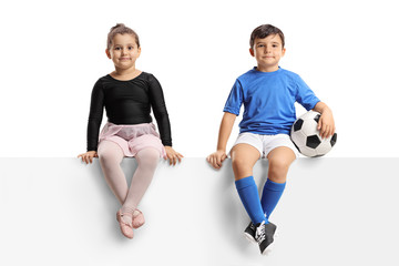 Little ballerina and a little footballer sitting on a panel