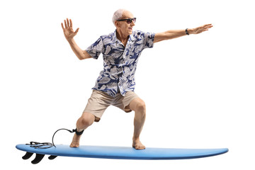 Senior surfing on a surfboard