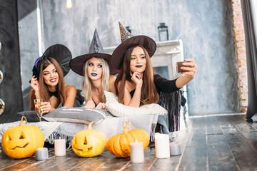 Spooky female friends posing on the selfie