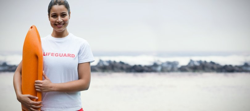 Composite image of portrait of female lifeguard holding rescue
