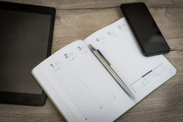 Calendar and smartphone with planning the days and weeks