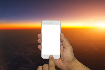 Hand holding phone with beautiful sky and sunrise