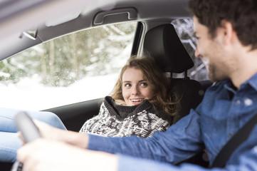Young couple on a road trip in winter