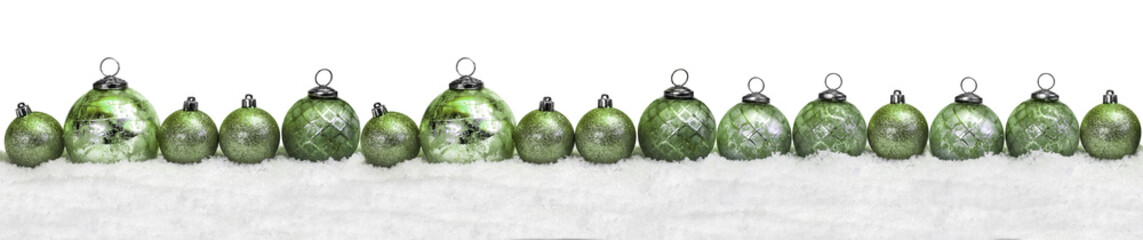Green christmas balls in the snow
