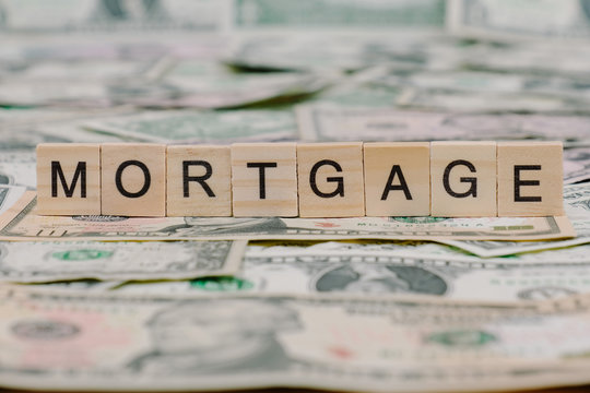 """the word """"MORTGAGE"""" written in wooden block letters"""