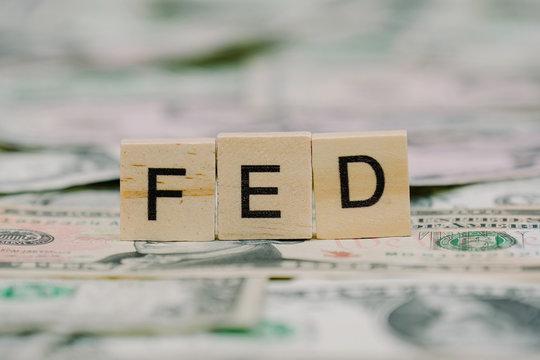 "the word ""FED"" written in wooden block letters"