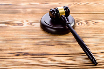 Judges gavel and sound block on wooden background. Concept of rule of law and justice