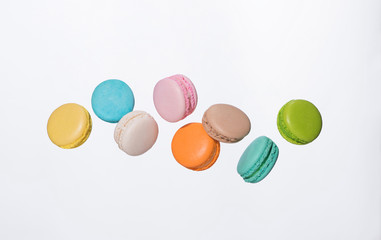 Aluminium Prints Macarons Colorful macarons cakes. Sweet french macaroons flying in motion.