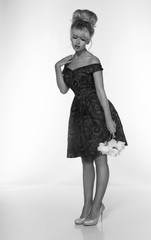 portrait of a beautiful blonde woman in retro dress 50-s style . monochrome black and white photo