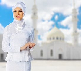 Young muslim girl at mosque background