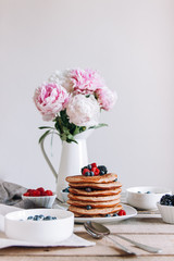 Delicious breakfast on table with flowers