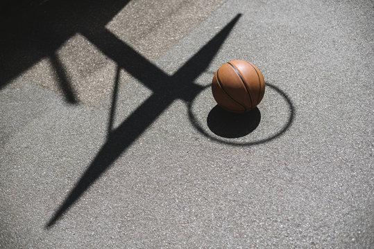 Basketball in shadow of a hoop