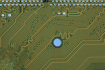 close-up of electronic circuit golden board background of computer motherboard