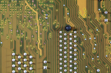 close-up of electronic circuit golden board background of computer motherboard.