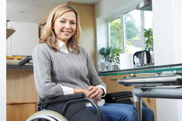 Portrait Of Mature Disabled Woman In Wheelchair At Home