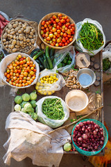 Overhead view of fresh vegetables selling on a table in outdoor local market in India
