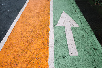 Color coded walking lanes with directional arrows