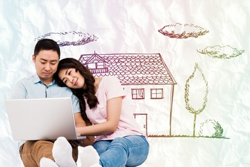 Composite image of couple working on laptop