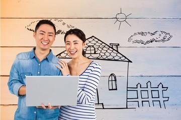 Composite image of portrait of couple using laptop