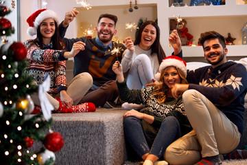 Christmas sparklers- people enjoying party on Christmas.