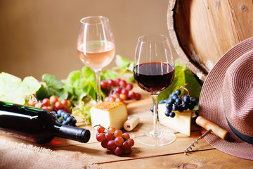 Wine glasses, cheese, grapes, hat and barrel