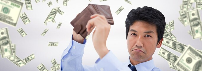 Composite image of businessman showing his empty wallet