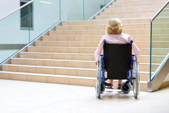 woman on wheelchair and stairs