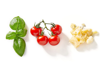 Parmesan cheese, basil and tomato isolated on white