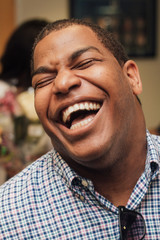Man Smiling and Laughing